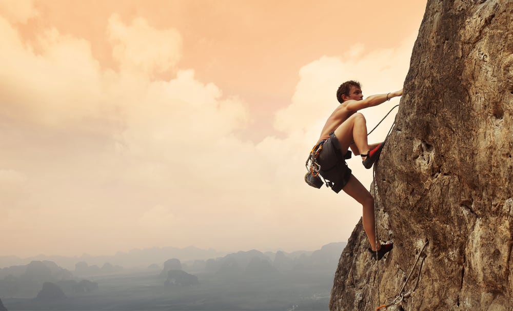 Man climbing in the hill