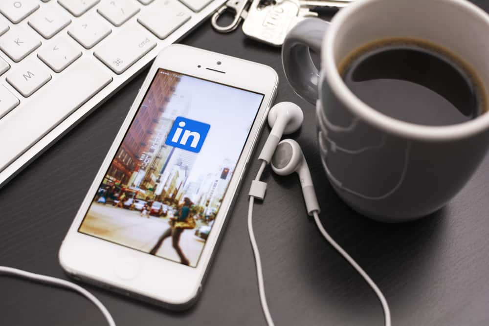 LinkedIn app icon shown on mobile phone