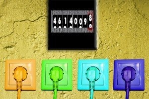 coloured plug sockets on wall with meter reading above