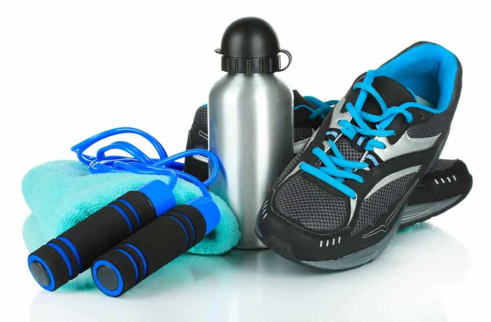 health and fitness equipement - trainers, skipping rope and water bottle.
