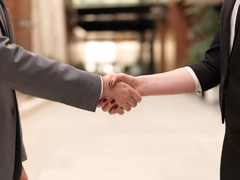 Partnership marketing - two people shaking hands