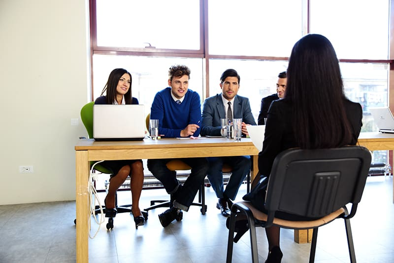 Woman sitting at job interview in office