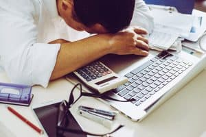 Accountant businessman working in office having a stress.