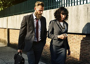 two business colleagues walking along the street