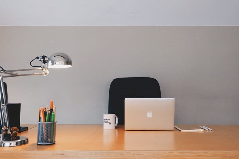 Virtual office - office chair, computer, mug and lamp on desk