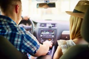 Young couple doing a car trip - 6 Car Loan Application Tips for Fast Approval Planning to purchase a car for your business? One of the most affordable ways to ge