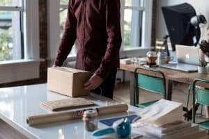 How to build, launch and grow an e-commerce business online - wrapping up a parcel