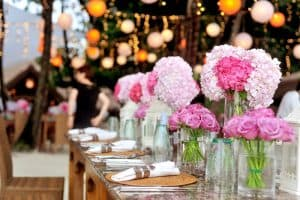 Dining table dressed with flowers, napkins and cutlery