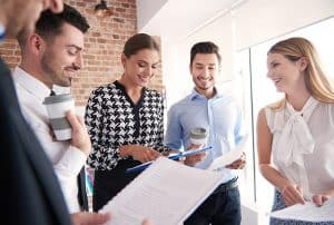 How to Attract Employees to Growing SMEs - Standing business meeting in the company