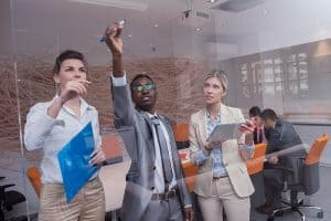 The 5 Key Assets of a Successful Company - young people having a meeting in a modern office