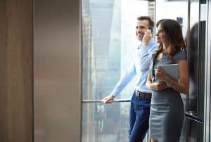 How to Take Your SME to the Next Level - Business partners in the elevator