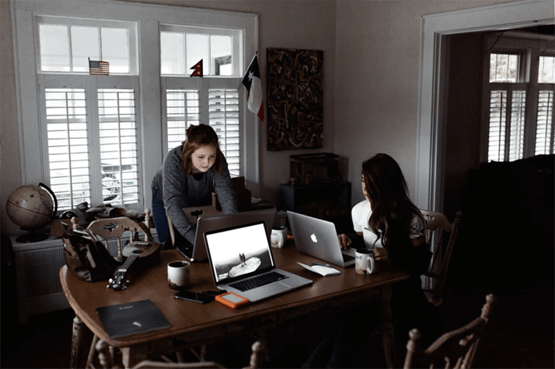two bloggers at work in their office