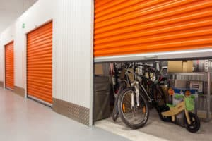self storage unit bicycle personal belongings orange shutter