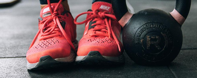 kettle bell weights red training shoes Nike
