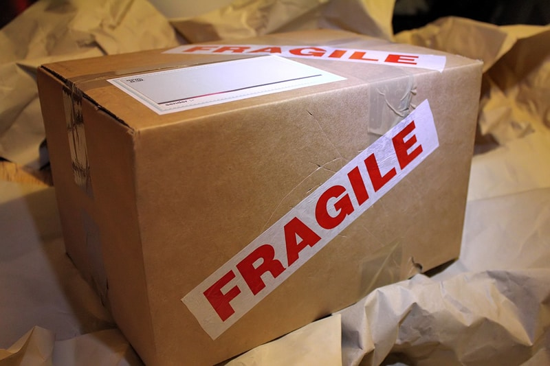 brown cardboard box parcel fragile tape