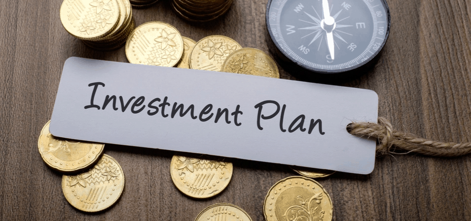 coins on table investment plan label on top