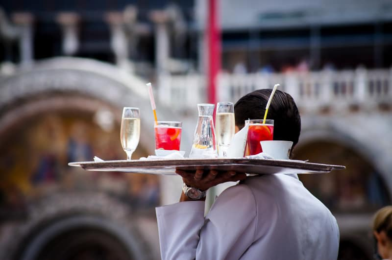 Waiter carrying a tray of drinks