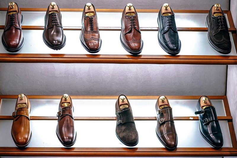 Black and brown classic shoes on shelf