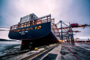 Black container ship at dock