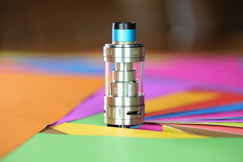 vape electronic cigarette uwell on coloured paper