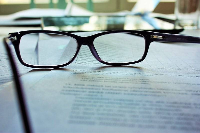 Reading glasses on documents on a table