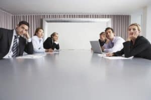 group of bored employees in a meeting room