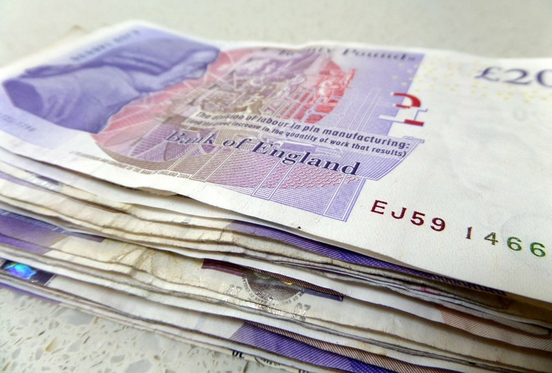 Stack of 20 pound notes sterling cash