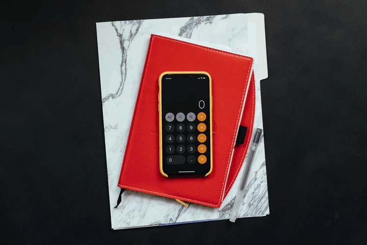 calculator on red notebook - Making Tax digital