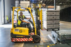 PErson using a forklift in warehouse