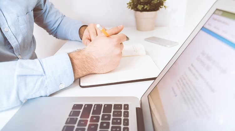 transferable skills for a ceo - businessman working and writing notes in office