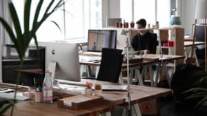 person working at desk in trendy office space