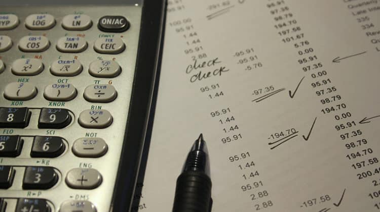 Tips for Organising Your Company's Finances - calculator and list fo figures