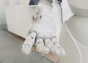 Artificial intelligence AI close up photo of white robot arm