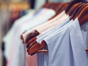 Clothes on hangers on rail - garment business