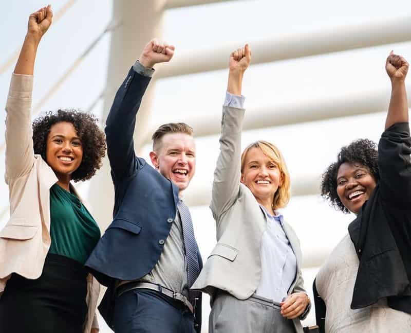 Tips for Creating a Positive Work Environment - happy employees