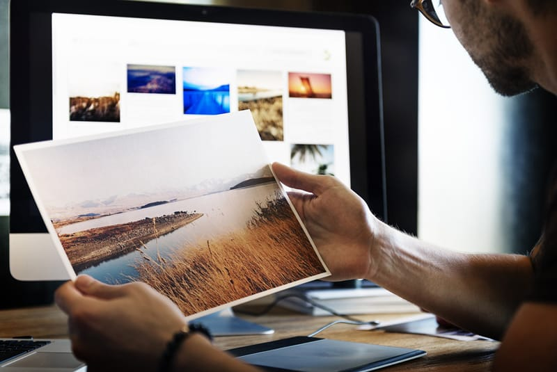 Must have graphic design skills - person holding photograph