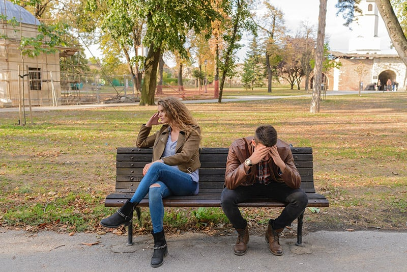 How a Private Investigator can Help your Divorce Case - man and woman upset with each other - sitting on park bench