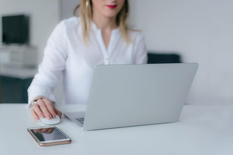 woman using silver laptop doing email address verification