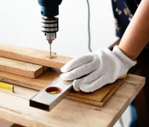 Most Important Tools - DIY project - person drilling hole with electric drill