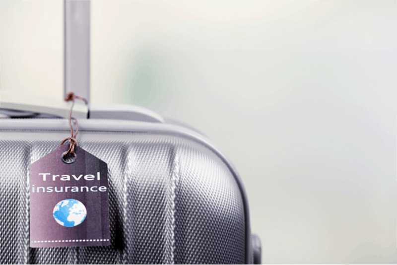 Suitcase with travel insurance tag