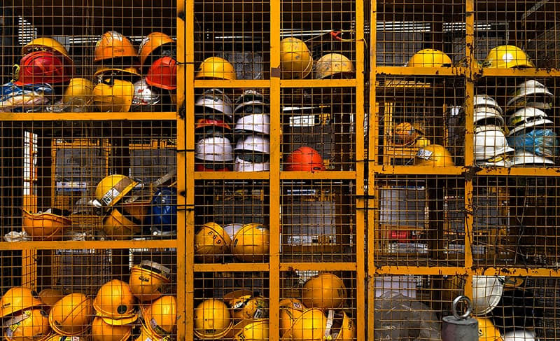 construction helmets – health and safety hard hats in storage cage