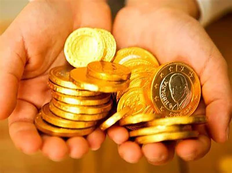 person holding gold coins - precious metals