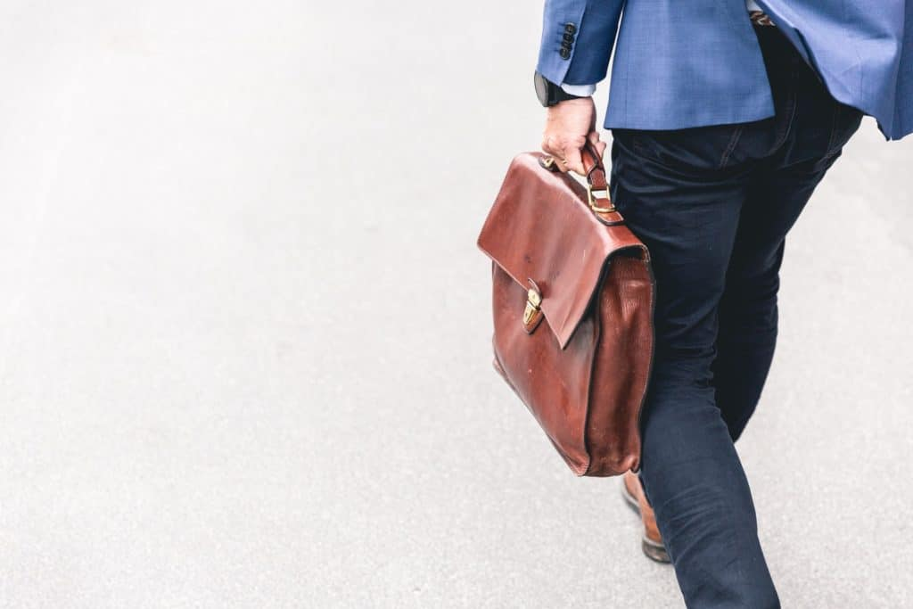 Man walking around with business casual outfit something that have become less common which the increased amount of workplaces with casual dresscode.