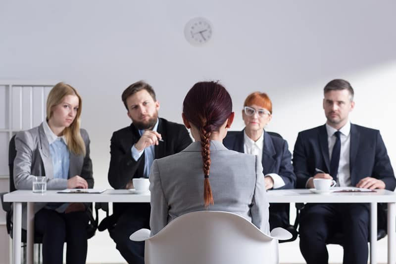 applicant being interview by a panel of interviewers