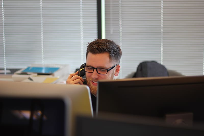 Man using landline in office