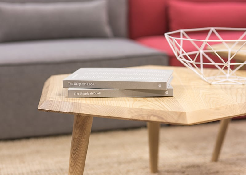 two grey books on coffee table