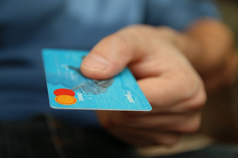 Importance of debt recovery. - person holding a credit card