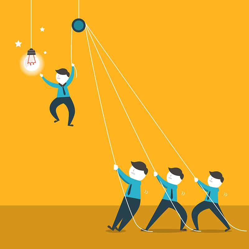 Vector of a team hoisting up a teammate to reach a lightbulb.
