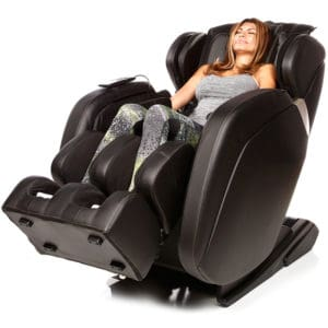 Lady relaxing in a massage chair