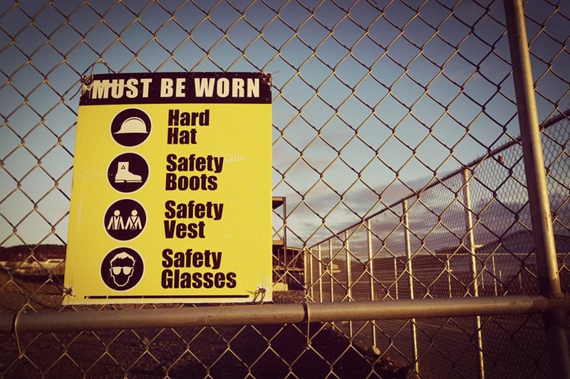 Health and safety at work sign on fence